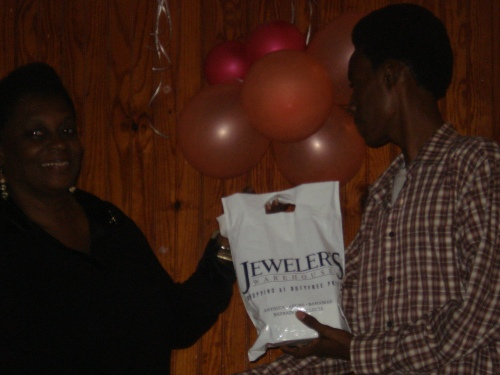 Jeweler's Warehouse was one of the main prize donors in 2010. Here art winner Shem Alexander collects his prize from the Antigua and Barbuda Museum's Michelle Henry.