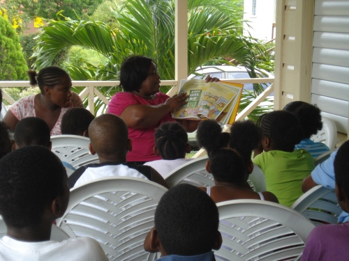 Ms. Nelson pictured reading to the children at the Cushion Club during the period when I was an active volunteer with the club and invited her to stop by.