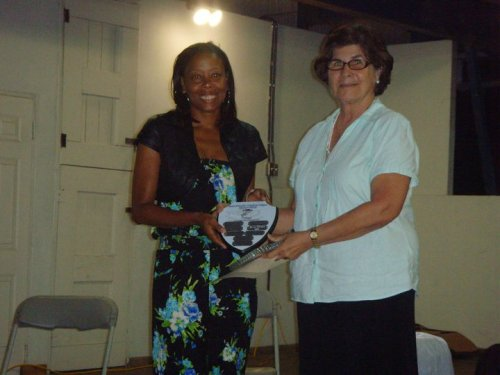 Devra posing with the Challenge plaque in 2011 alongside Best of Books owner E.M. Grimes-Graeme.