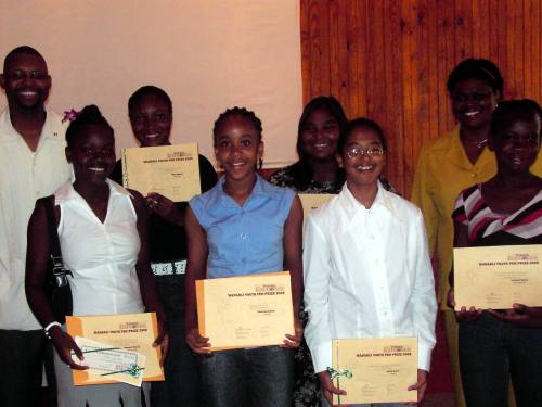 2005 Wadadli Pen finalists flanked by then Youth Minister (guest speaker at the awards ceremony) Winston Williams and co-founder and then chief WP judge D. Gisele Isaac.