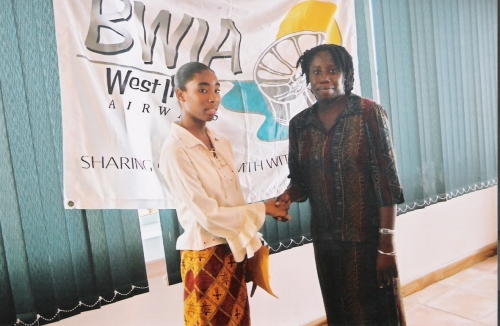 Joanne C. Hillhouse, right, with first Wadadli Pen winner, Gemma George left during the awards ceremony held in 2004 in the Heritage Hotel conference room. Her winning story was Stray Dog Prepares for the Storm.