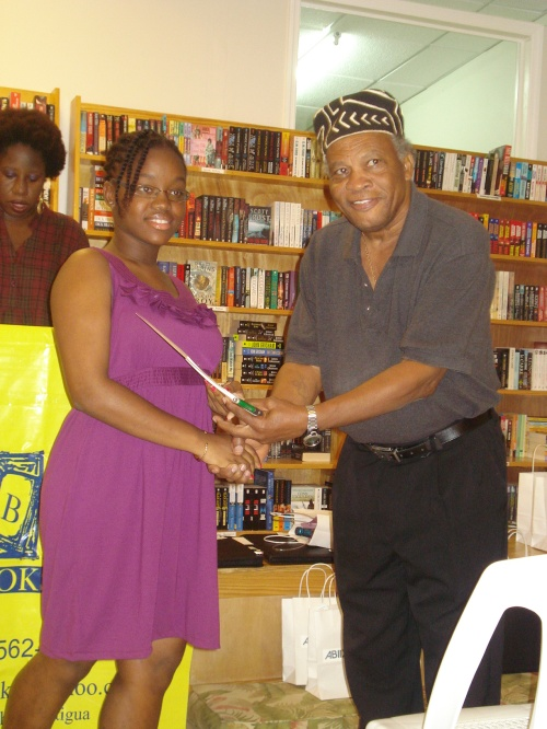 Jordee Josiah collecting her prize from guest speaker Mali Olatunji during the 2012 awards ceremony.