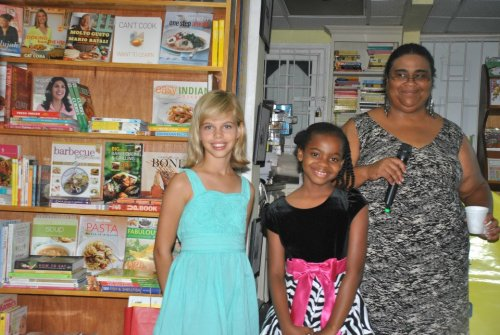 Best of Books manager Barbara Arrindell with 2013 top junior writers Vega Armstrong, left, and Chammaiah Ambrose, right. Vega was an honourable mention in 2012; Vega was second and Chammaiah third 12 and younger in 2013; Vega won the category in 2014 and Chammaiah was again her runner up. Chammaiah, like other past finalists (Orique Gordon, Asha Challenger, Michaela Harris, Verdanci Benta and more have participated in writing workshops led by Joanne C. Hillhouse, most recently the Jhohadli Summer Youth Writing Project)