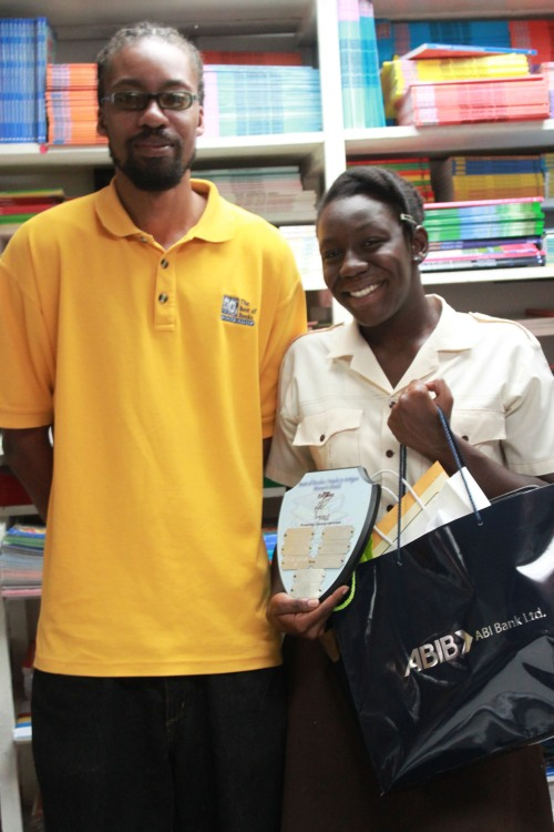 This is Glen with our 2012 Wadadli Pen winner Rosalie at the  Best of Books, a project partner and his employer. Rosalie is holding the challenge plaque sponsored by the Best of Books and other gifts.