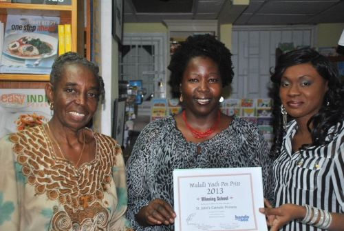 Teachers from St. John's Catholic Primary, 2013, collecting the prize for most submissions by a secondary school. The prize was US$500 worth of books towards a school library, sponsored by Hands across the Sea.