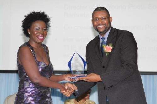 Linisa George accepting her National Youth Award for contribution to the Literary Arts.  (This is a Eustace Samuel Photo from the Observer newspaper facebook page)