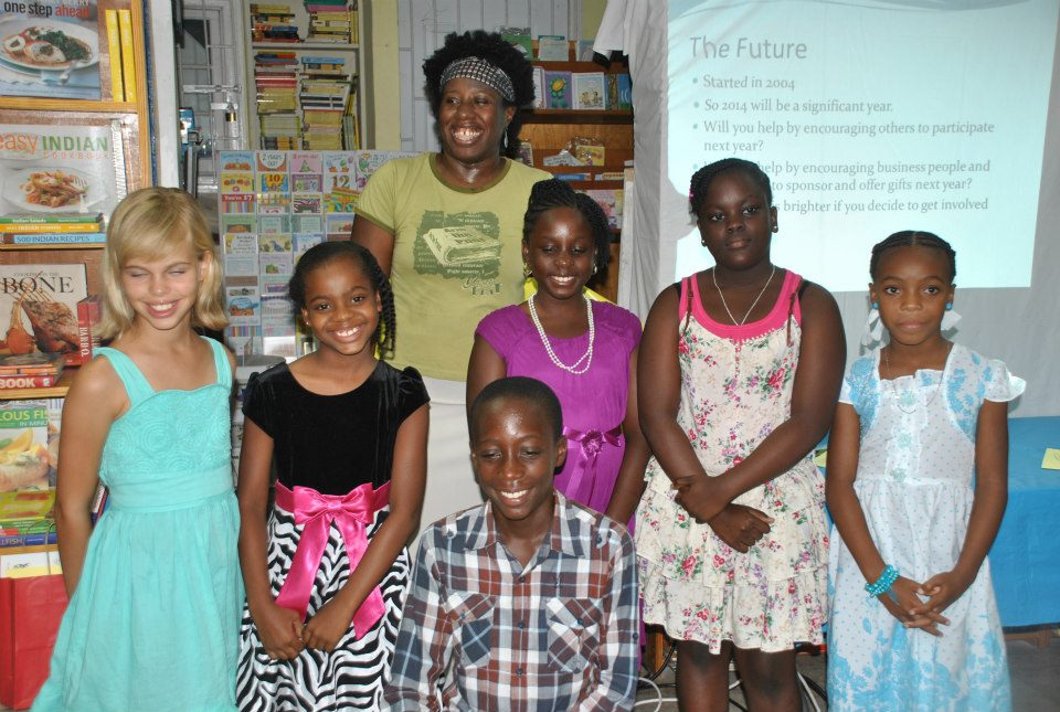 Me, with the youngest of the 2013 Wadadli Pen finalists - art and lit. (Photo courtesy Antigua Chronicle)