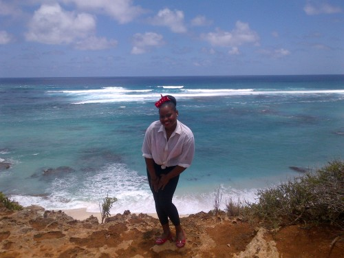 This is a picture of a visit to the sister island by one of our prize winners and a friend; the friend's the one in the picture - click on the picture for her review of the experience.
