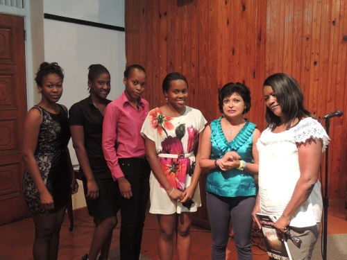Kris, second from right, with Antiguan writers Joy Lawrence, right, Floree Williams, third from right, and, remaining, members of the Young Poets Society of Antigua and Barbuda who came out to participate and support. Incidentally, this will be Floree's third year as a volunteer judge with Wadadli Pen, and Joy's first year as the point person on schools outreach for our 2014 Challenge Season. Writers, supporting each other.