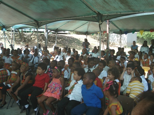 Kids Unlimited students listen to a presentation by Lawrence.