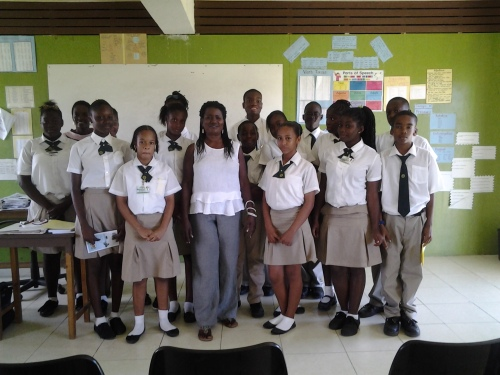 Joy with students from Trinity Secondary School.