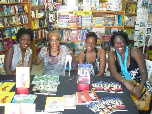 with Linisa George, Brenda Lee Browne, and Floree Williams at one of two Antiguan Authors table set up at the Best of Books on Dec 14 2013