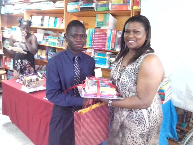 Gisele presents to second placed writer 13 to 17 Kelvin Juwon Miller.