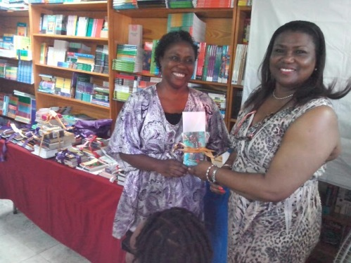 Margaret Irish - winner of the Lead by Example Teachers Prize collects her gifts courtesy Caribbean Reads Publishing and plaque sponsored by Joy Lawrence. This prize was added to Wadadli Pen as a way of encouraging students by encouraging teachers.