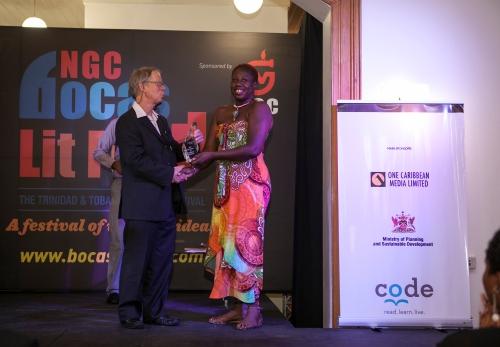 With sponsor of the Burt Award, William Burt - Photo source http://www.bocaslitfest.com/2014/jamaican-author-a-dziko-gegele-wins-the-inaugural-burt-award-for-caribbean-literature/