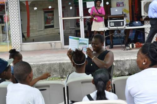By golly, I think they're into it: Calesia Thibou reads from her book Cadriel and Jadiel: a Day at the Beach.
