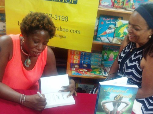 And here I am signing copies for readers like local attorney E. Ann Henry.
