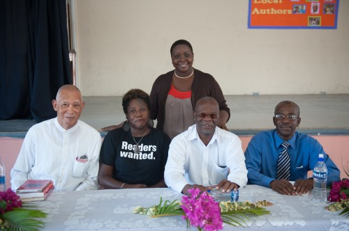 W/teacher Ms. Shadrach (standing) and visiting authors (seated) from left Max Hurst, Timothy Payne, and Sylvanus Barnes.