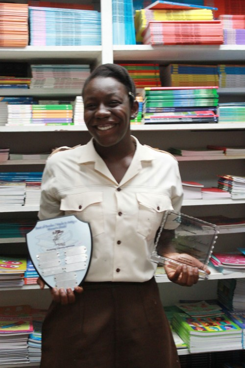 Here's 2012 winner Rosalie Richards, in the bookstore, hoisting the Challenge trophy, just one of the things sponsored by the Best of Books.