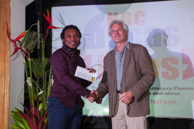 Poet Vladimir Lucien, overall winner of the 2015 OCM Bocas Prize for Caribbean Literature, receives his prize from judge Laurence Breiner at the Award Ceremony during the NGC Bocas Lit Fest in May 2015.