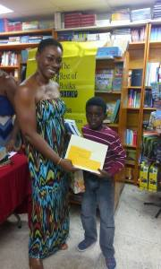 2015: Judah collecting his prizes from guest reader/presenter Dotsie Isaac Gellizeau. Be sure to check out her CD, I am Speaking.