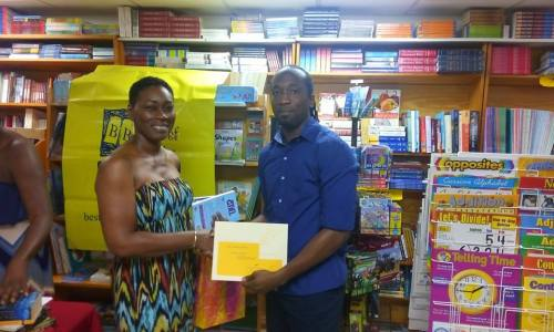Olsfred collects his prizes, sponsored by the Best of Books and the Burt Award, from poet and guest presenter Dotsie Isaac Gellizeau, who released her CD 'I am Speaking' earlier this year.