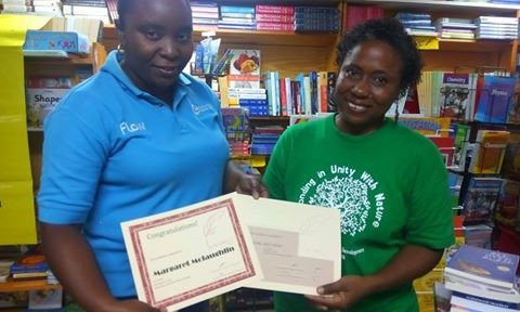 Irish collecting certificates from one of the Wadadli Pen 2015 patrons, Flow, represented by Gavinia Michael.