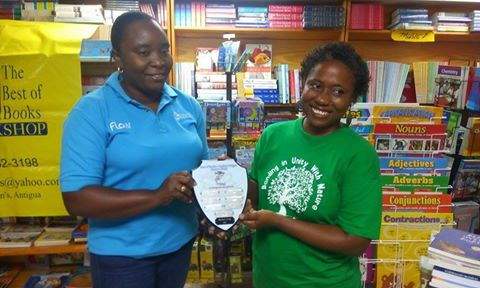 Irish's name will join that of past winners emblazoned on the Wadadli Pen Challenge trophy sponsored by the Best of Books. Pictured making the presentation is Gavinia Michael of Flow, one of the 2015 Wadadli Pen patrons.