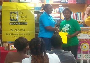 Gavinia Michael representing Flow, presented a $500 gift certificate on behalf of the company and assisted with the presentation of other prizes to winner Margaret Irish.