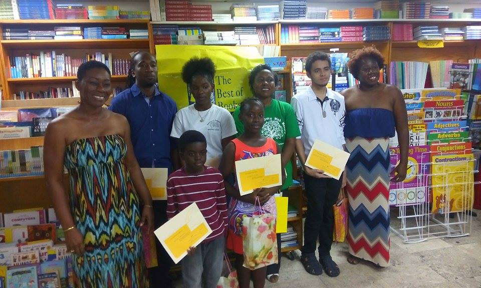 The Wadadli Pen Awards ceremony photo call: pictured, from left guest presenter and poet Dotsie Isaac Gellizeau, Olsfred James, Melicia McCalmon, Margaret Irish, Ondrej Austin-McDonald, and founder/coordinator of Wadadli Pen Joanne C. Hillhouse (author of Musical Youth and other books). Front are the two youngest prize recipients of 2015 Judah Christian, 8, and Avriel Walters, 10.
