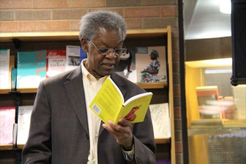 Dr. Llewelyn Joseph, one of the contributors, reading from So the Nailhead Bend, So the Story End during the book's Canada launch. (Photo reprinted with permission - do not steal)