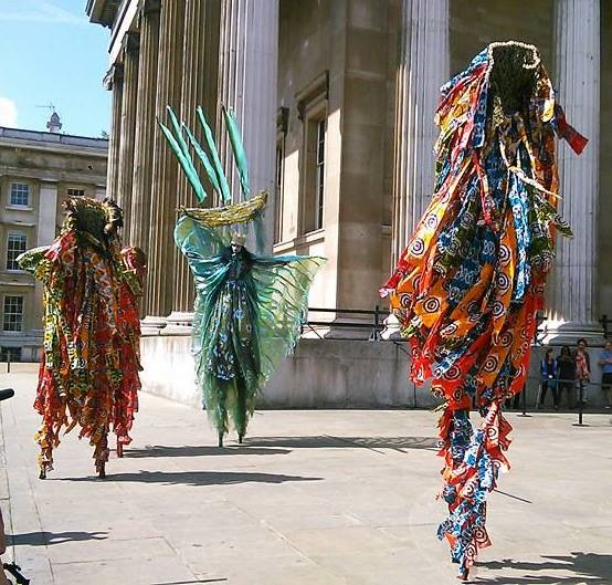 The film Ah! Hard Rain is the story of a fishing village struggling to survive due to over fishing by huge trawlers from, Europe, China, etc. The film sponsored this special performance at the British Museum, on Saturday 15th August, 2015 by providing two of the amazing Moko Jumbie performers, all the way from Trinidad & Tobago, who feature in the soon to be released film Ah! Hard Rain. Photo is from the Ah! Hard Rain facebook page https://www.facebook.com/AhHardRain