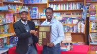 Winner Daryl George with Douglas Allen, brother of Alstyne Allen in whose memory the plaque is named at the 2016 Wadadli Pen Challenge Awards Ceremony.