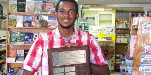 2020 winner Andre J P Warner with the Wadadli Pen Challenge plaque. Andre went on to win the Rebel Women Lit Caribbean Readers Choice of 2020 for best short fiction for his story 'Bright Future for Tomorrow'.